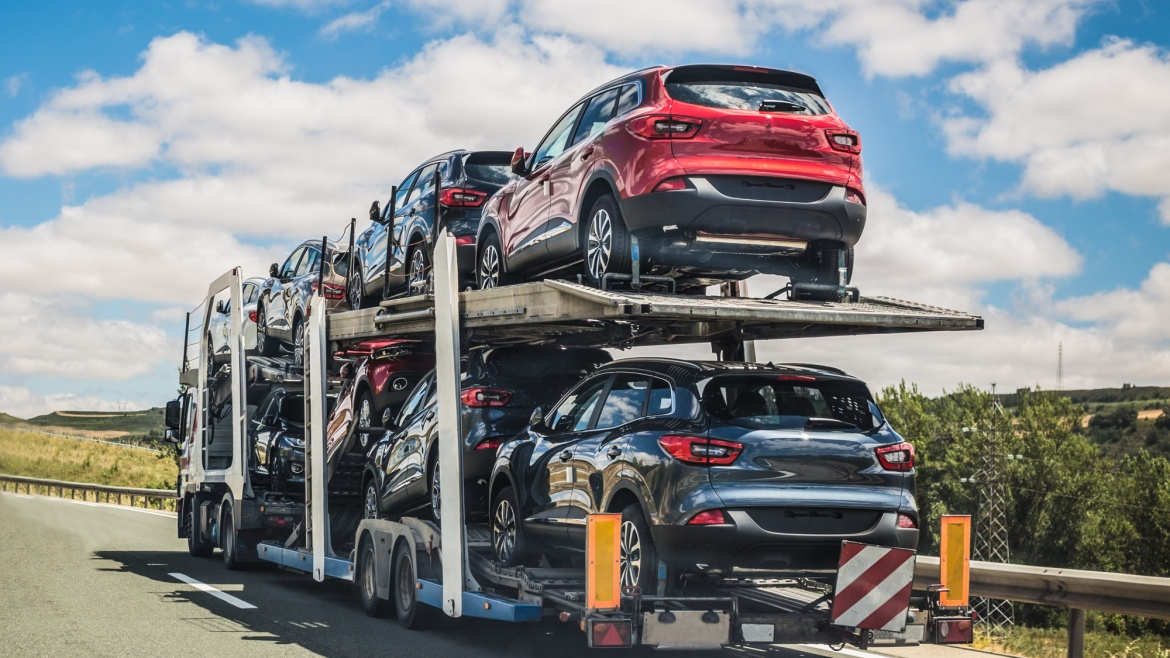 car transport truck carrying several vehicles
